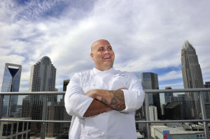 Chef Rocco Whalen's Fahrenheit restaurant atop Skye Condominiums features outdoor seating and a wraparound view of the Charlotte skyline